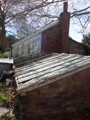 A glasshouse and cold frames at Sutton Court